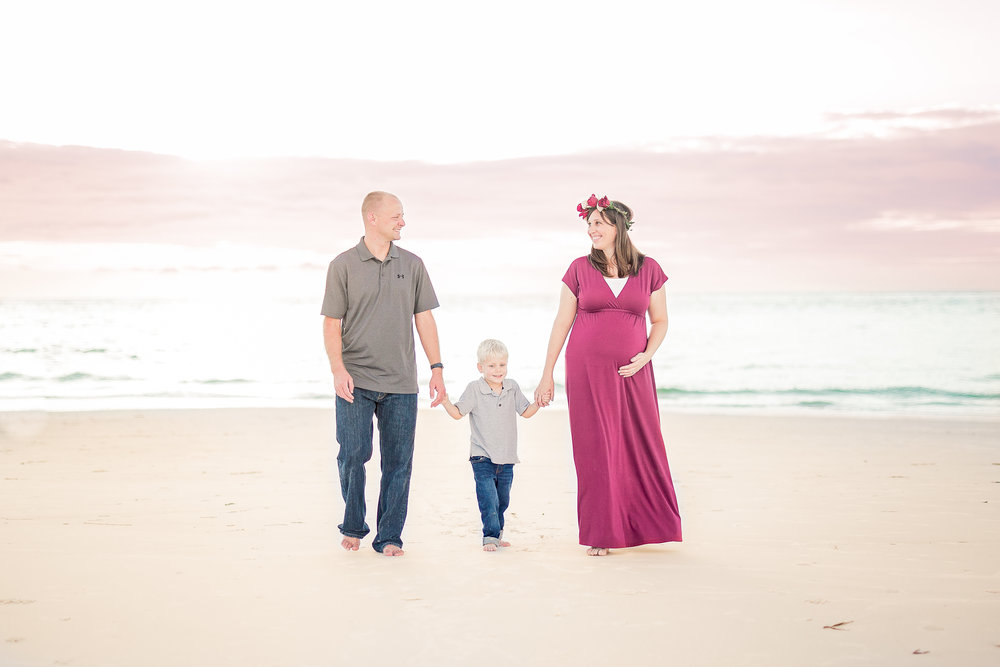 """- """"I love love love our family pictures. Suzy was a miracle worker. She coached me through what we should wear and had us laughing so hard during our session. Not only did my tweens have natural smiles, but my toddler was even looking at the camera and smiling! My husband mentioned that it was the best experience he's ever had!"""" – Amber D."""