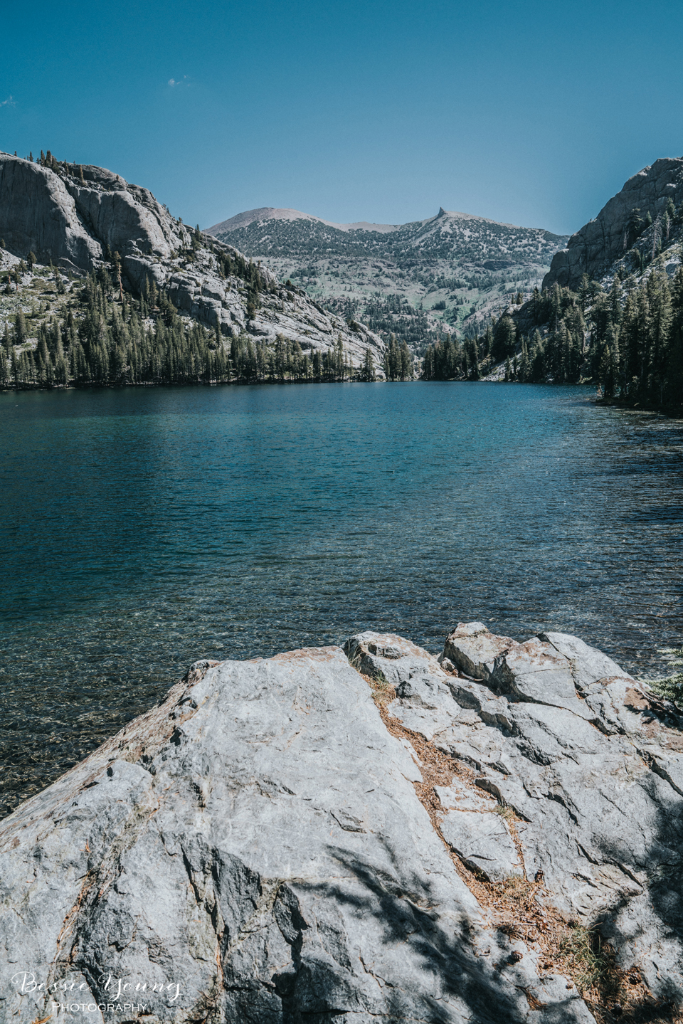 Ansel Adams Wilderness Backpacking. This is Rosalie Lake along the John Muir Trail. Landscape Photograph of a High Mountain lake photographed by Bessie Young