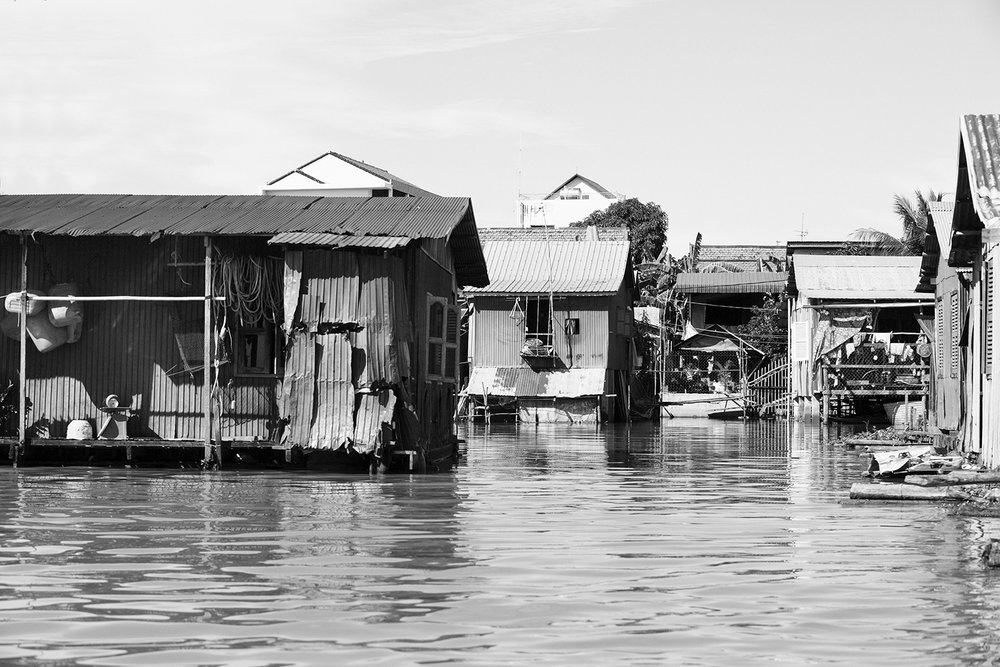 Floating homes. During the dry season these homes will rest on land or sit in very shallow water.