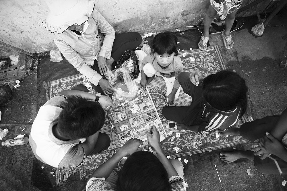 Youth gambling and drinking is a problem. Sadly we saw many children carrying fist-fulls of small money and torn game boards littering the ground.