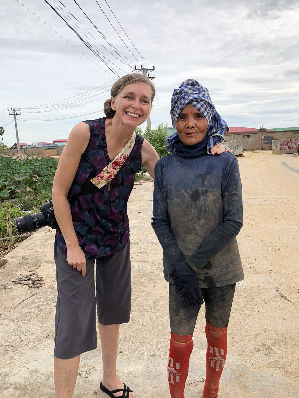 """Kirsten with Srey Nher, one of the first women photographed for the project. When asked what her hope for the future is she said she didn't have hope as she is """"old and poor."""" Kirsten asked if she knew Jesus and Srey Nher said, """"Yes, I've heard but I don't see how that (He) can help."""" We are thankful for this open door for sharing the hope we have in Christ, and pray that the relationship with this woman and her husband (who is 98 (!!) and was also photographed for the project) will grow. Pray for this sweet couple. We feel blessed to have met them and feel they are among those that the Lord desires for us to serve in practical ways."""