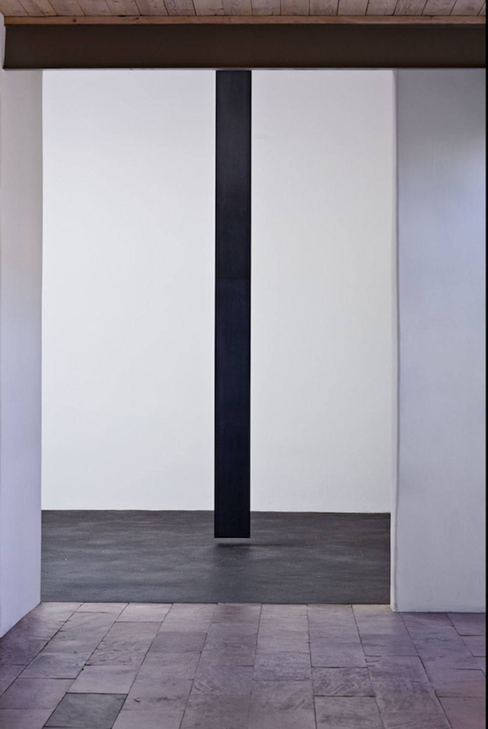"Floating Column, 2008  Solid graphite, 14' x 10"" x 10"" x 9.5""  Lannan Foundation collection. Photo: Jamey Stillings"