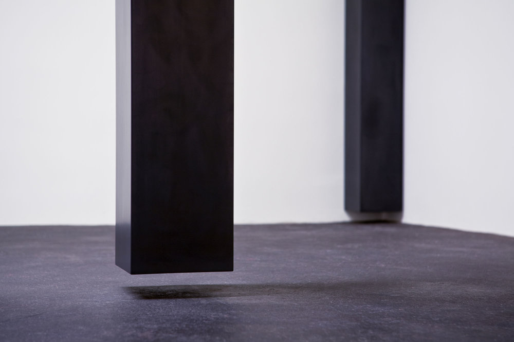 "Floating Column, 2008  14' x 10"" x 10"" x 9.5"", Solid graphite, Collection: Lannan Foundation"