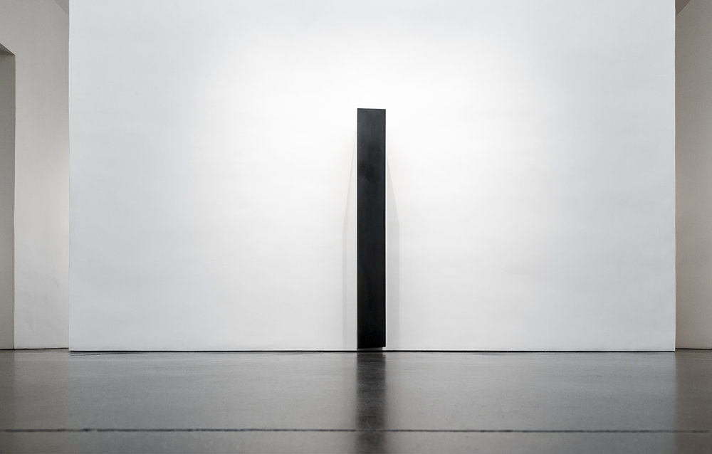 "Tilted Column , 2008  70"" x 14"" x 15"", Solid graphite"
