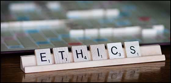 An image of scrabble tiles spelling out the word ethics.