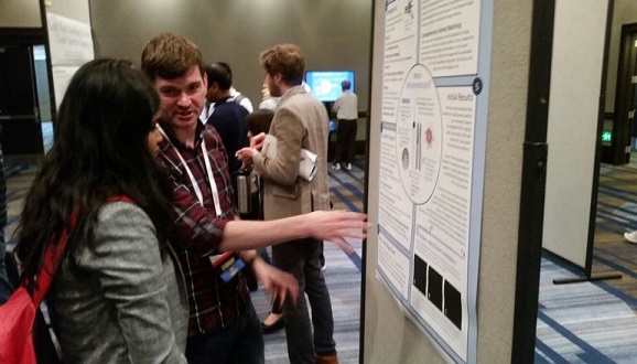 This is me (again) presenting my poster at the networking event