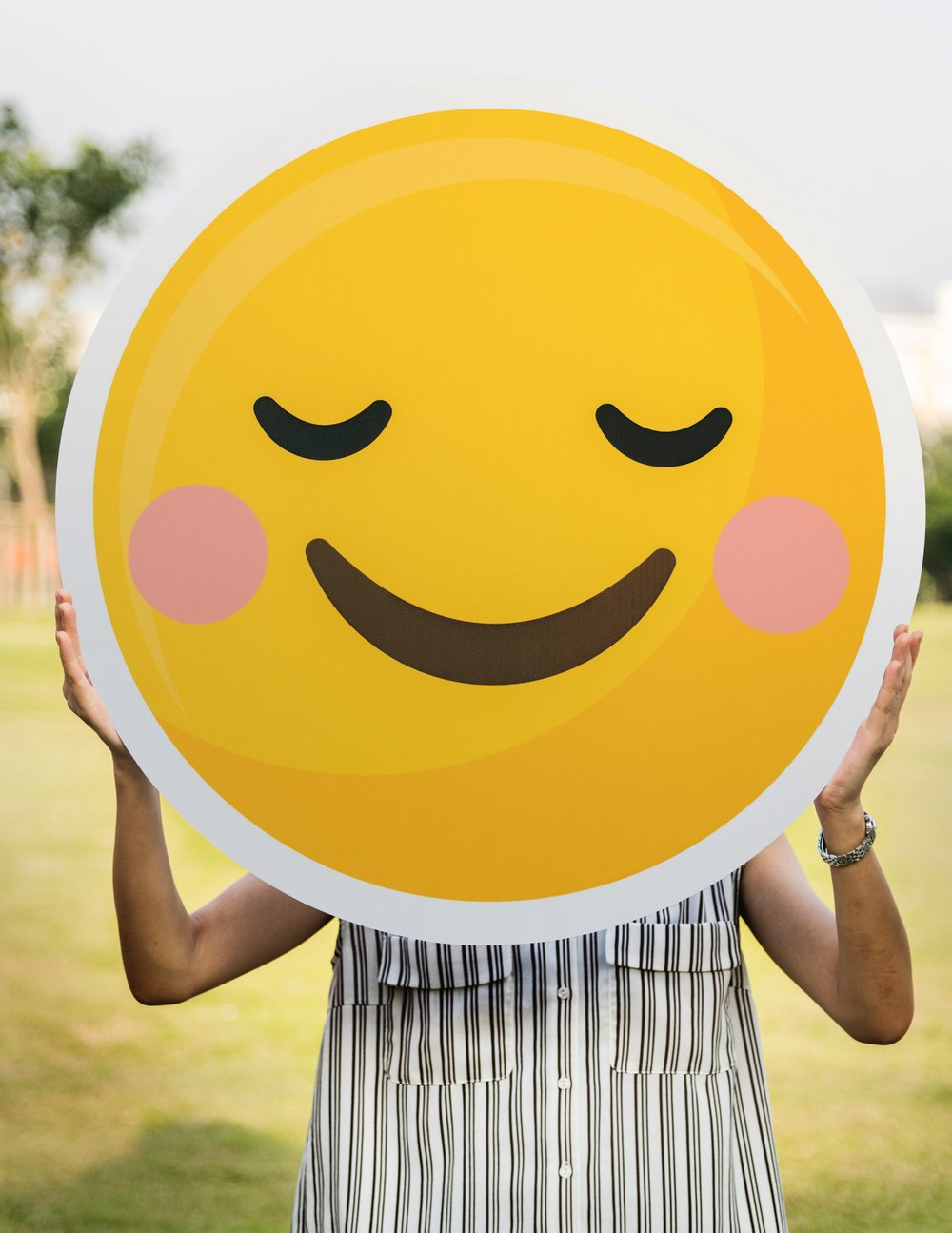 Photo of person holding up smiley face by  rawpixel  on  Unsplash
