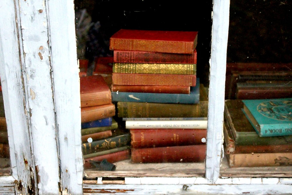 Stacks of books on a window