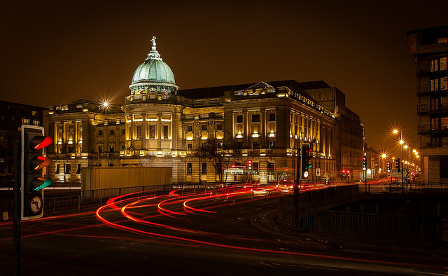 [Image description: Glasgow's Mitchell Library at night, photo taken from across the highway.]
