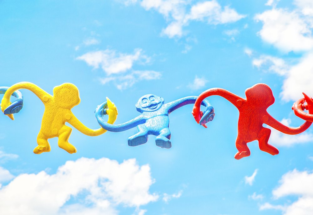 Colourful plastic monkeys in the sky