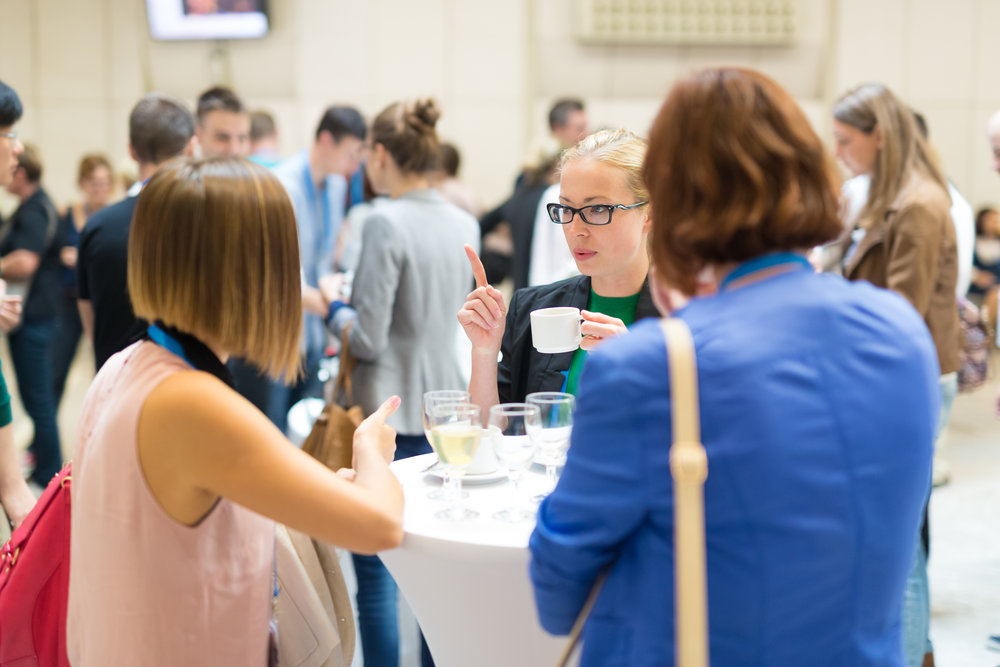 home - conference s-the-d -- stock-photo-people-interacting-during-coffee-break-at-medical-or-scientific-conference-483001048.jpg