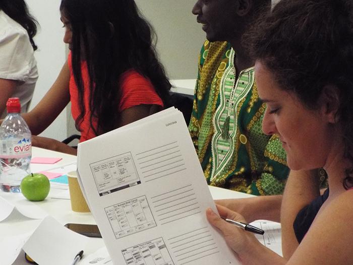 Delegates work through market strategies for their ideas