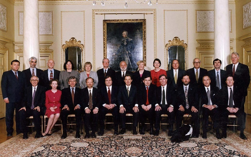 Tony Blair's first cabinet, with Margaret Beckett (front row) and Harriet Harman wearing red. Other women in the photo are: Clare Short, Mo Mowlam and Ann Taylor (all top row).
