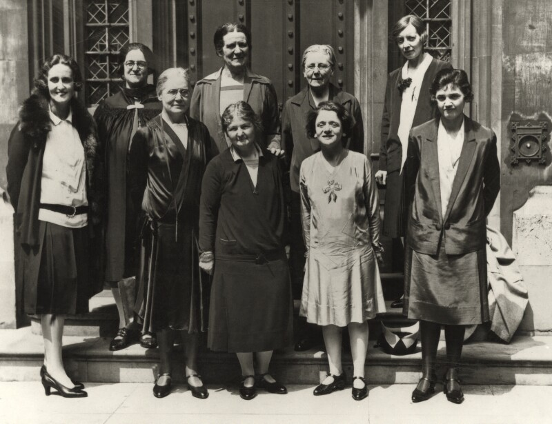 1929 photo of female Labour MPs, including Mary Agnes Hamilton (top right) whose shoes might very well be red… Ellen Wilkinson is in the front row, second from the right.   From the National Portrait Gallery's collection