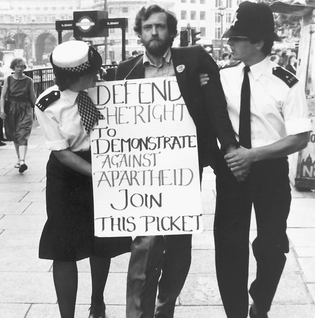 Here's Jeremy Corbyn getting arrested outside South Africa House in 1984. The photo was taken by  Rob Scott ;  read more about it here .