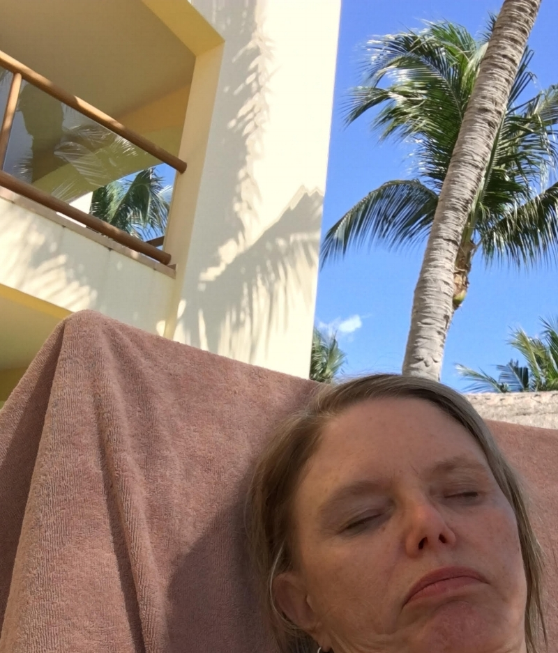 Me asleep in a lounge chair.