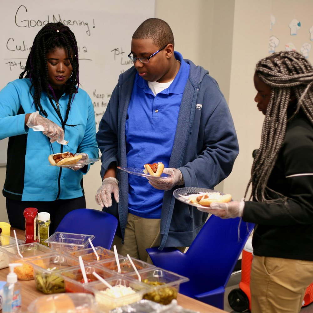 Burke High School students create their own signature hot dogs as part of a food costing exercise.