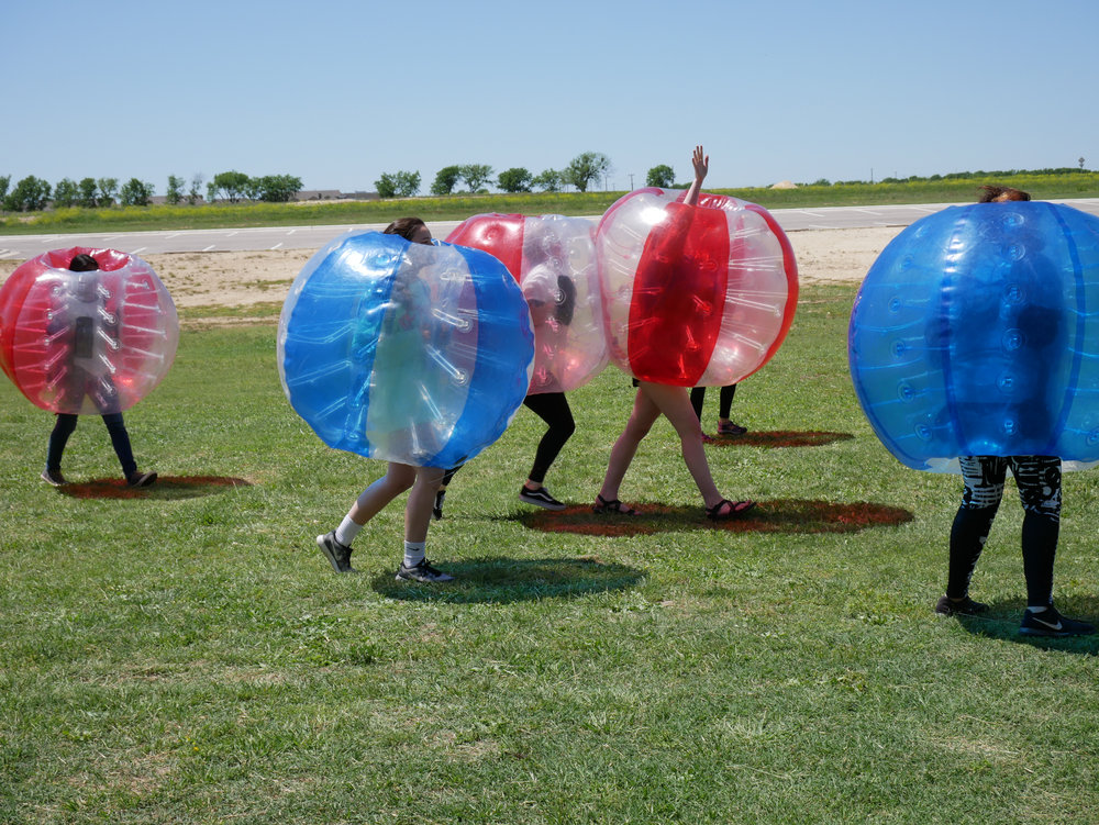 Girls playing bubble soccer!