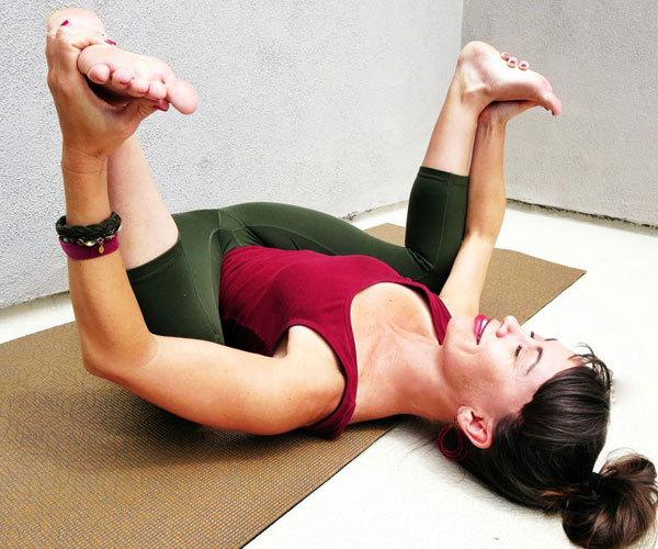 Beachbody-Blog-9-Yoga-Poses-HappyBaby