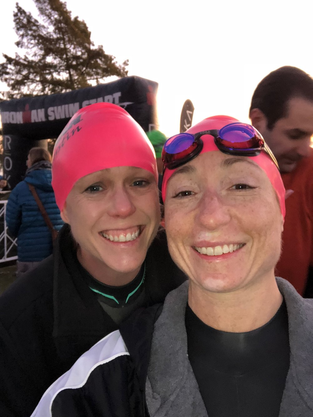 With teammate Susan Lambert trying to stay warm before the swim start.
