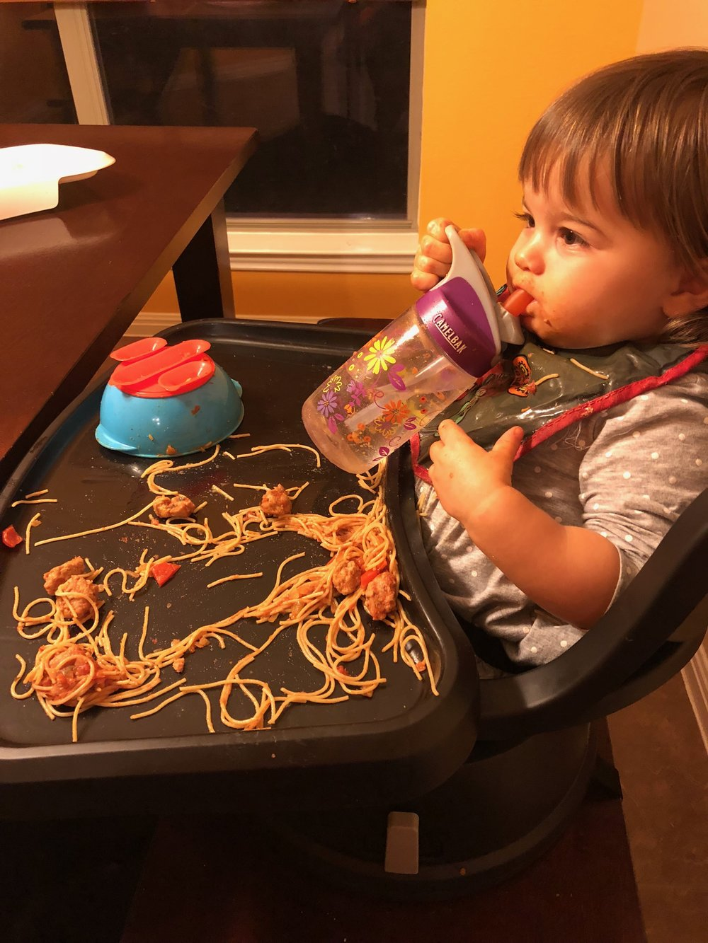 Pro tip from Adaline: Spaghetti tastes way better when you dump it out of the bowl and smear it all over your face.