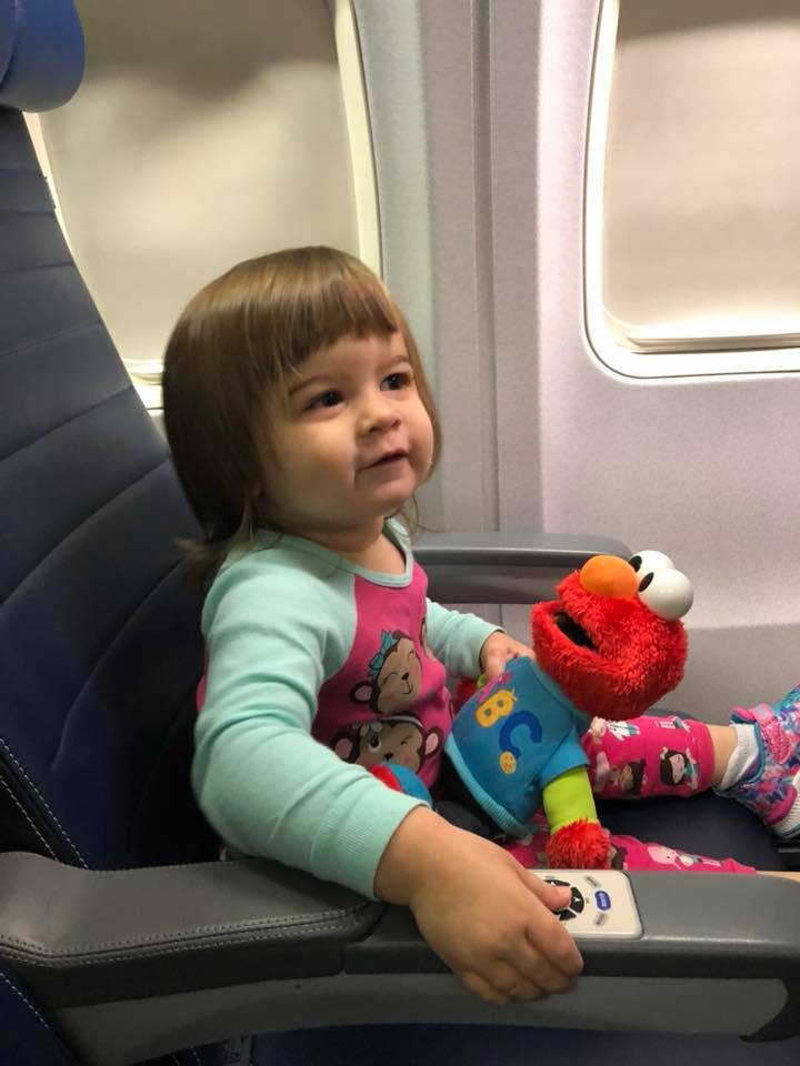 "Adaline and Elmo on the plane bound for Kansas to see ""Gram Gram."""