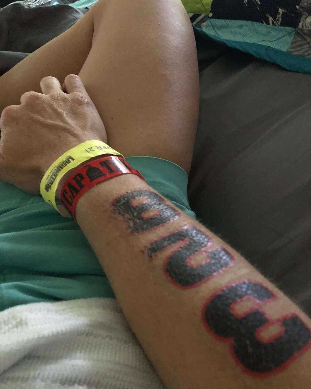 Sick in bed with my race number tattoos on Memorial Day instead of racing the CapTex Tri.