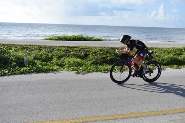 On the bike course at Ironman 70.3 Cozumel. Note the fancy, super-pro-looking helmet, which by this point was fog-free. (Photo courtesy of Daniel Guajardo)