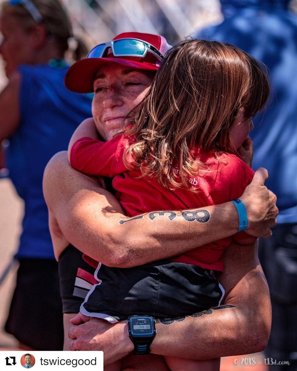Hugging my sweet Ada after finishing Ironman 70.3 Buffalo Springs Lake. (Photo by Travis Swicegood)
