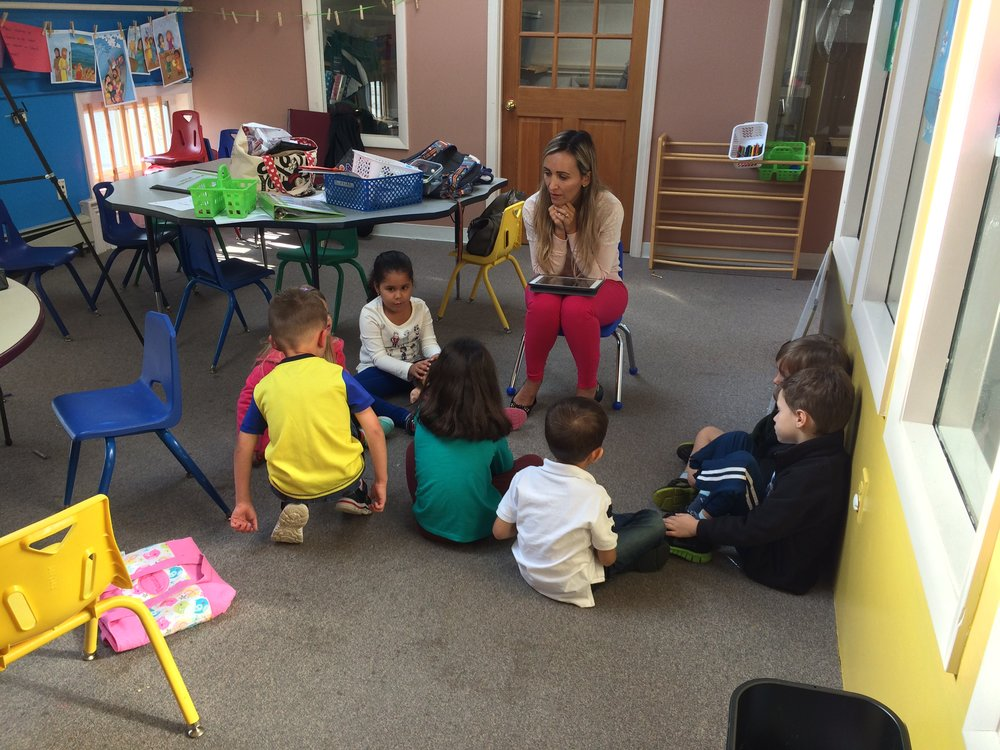 Students in the youngest Português Plus class sit for a lesson.