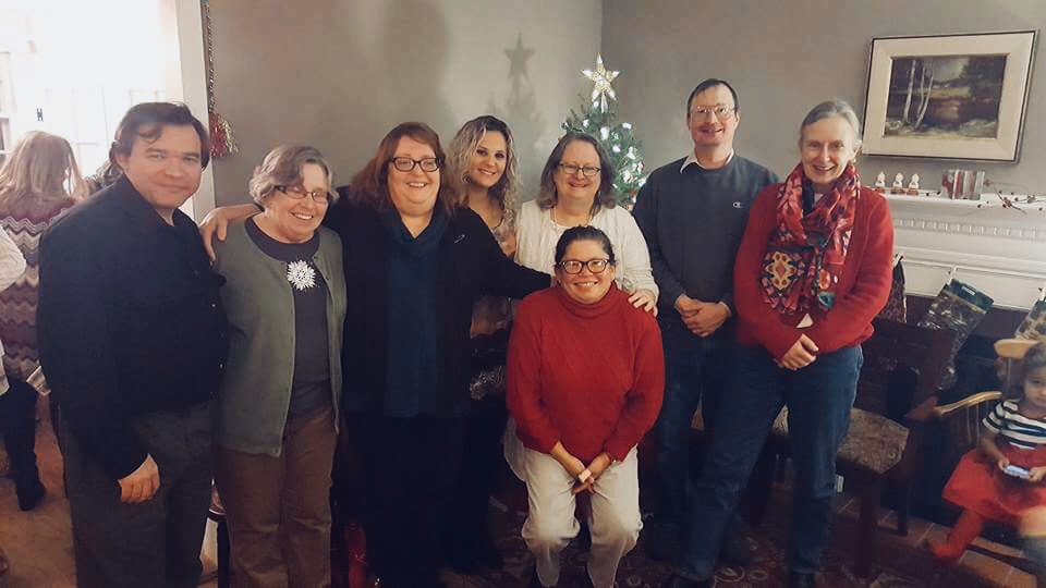 Board members and staff during a Christmas celebration.