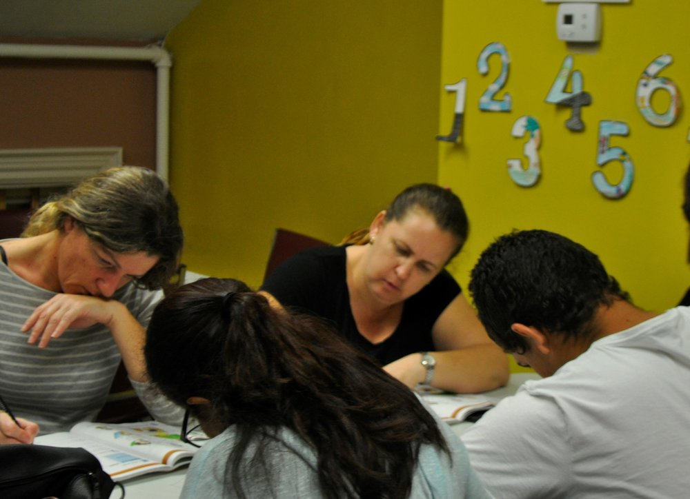 Students in the Marlborough ESOL class work on an activity. Photo by Elizabeth Kholer.