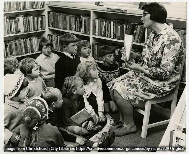 Librarian reading to children