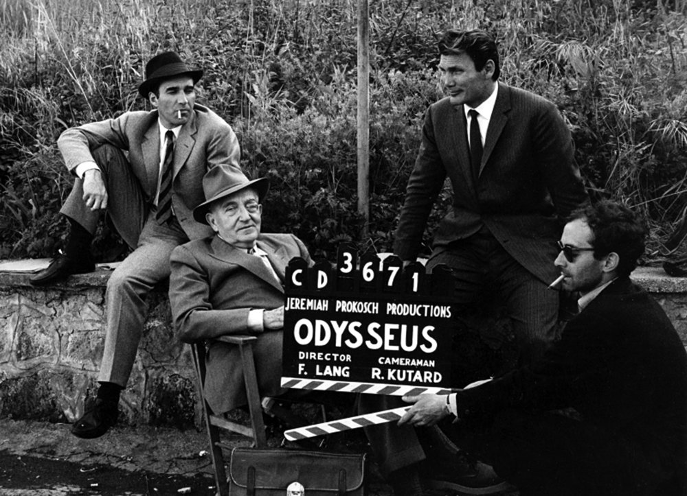 Godard, Fritz Lang, Jack Palance and Michele Piccoli on the set of Le Mepris, 1963