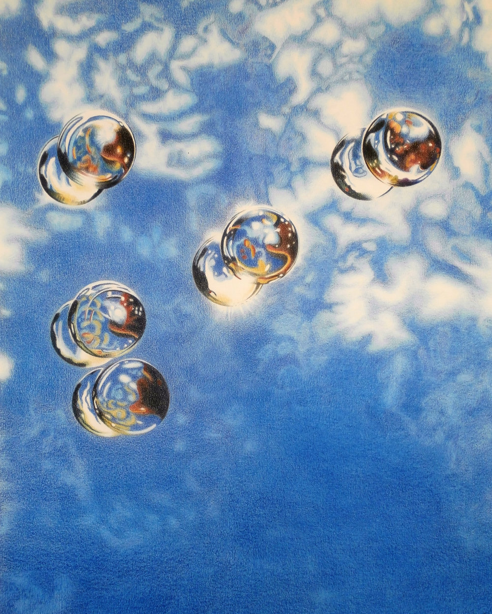 REFLECTIONS OF CLOUDS AND SPHERES