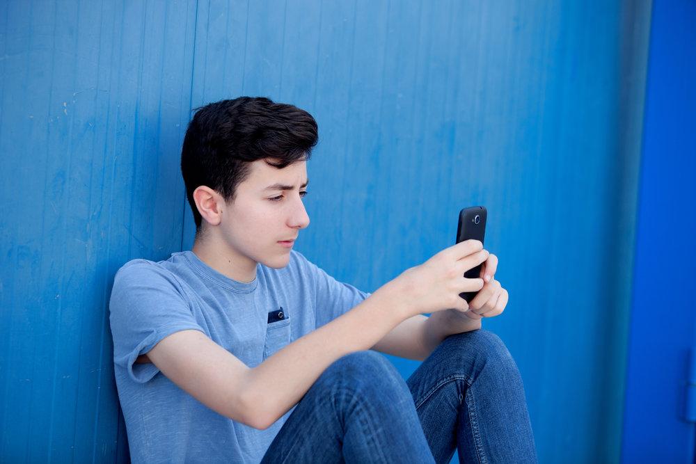 teenboywithphone.jpeg