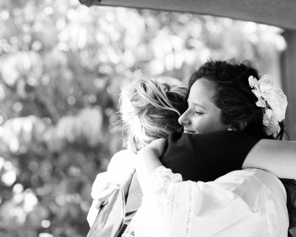 makeup artist and bride hugging black and white photo wedding photographer kim baker beauty san jose california makeup artist travel to sutter creek