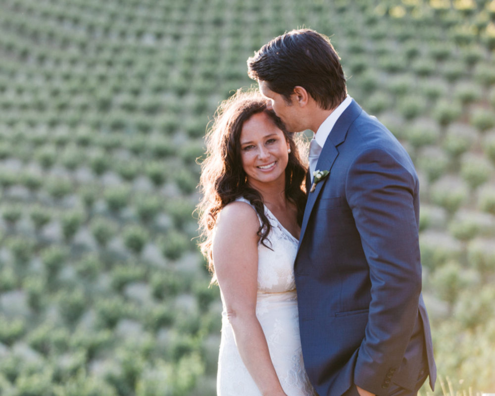 bride smiling and groom kissing her forehead during golden hour happy couple kim baker beauty san jose california makeup artist travel to sutter creek