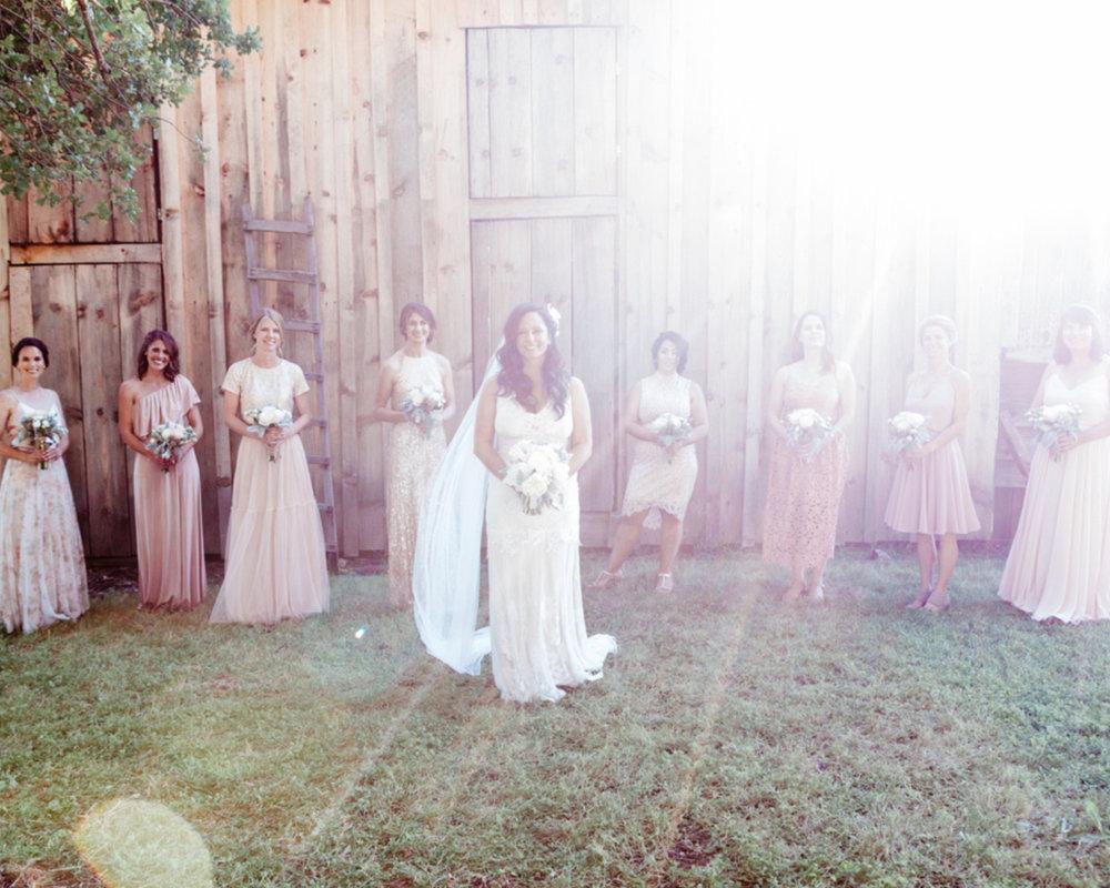 bride and bridesmaids in boho floor length rose toned dresses during golden hour kim baker beauty san jose california makeup artist travel to sutter creek