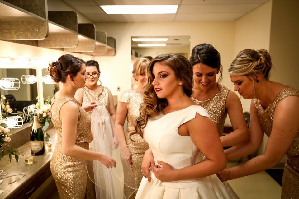 bride getting ready for ceremony with bridemaids in gold floor length dresses and dramatic makeup kim baker beauty san jose california makeup artist palo alto