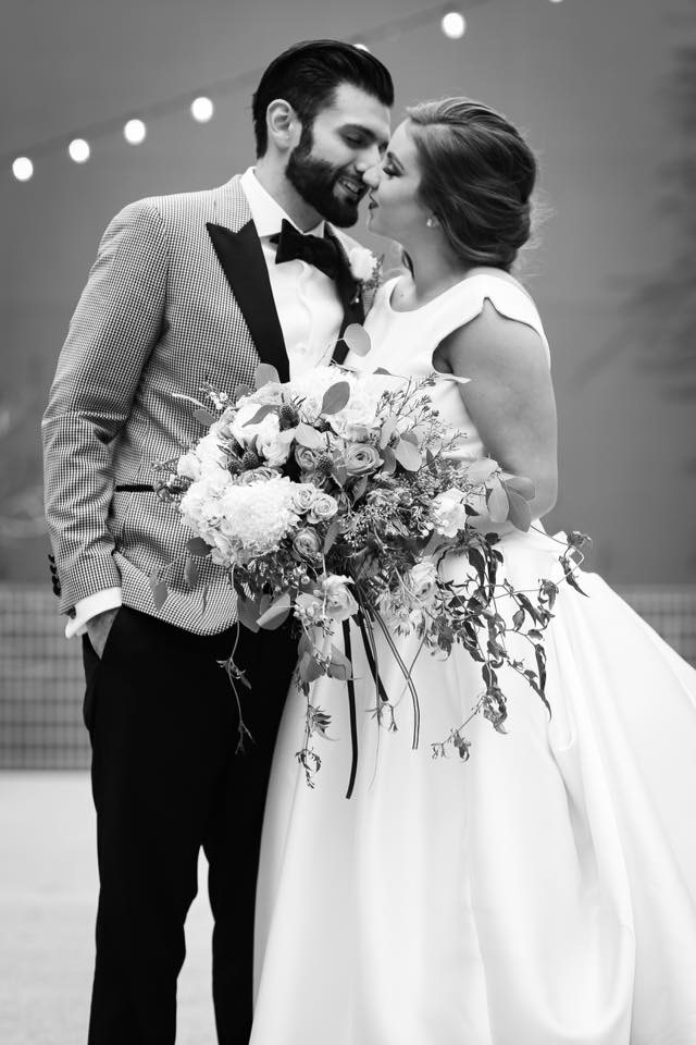 bride and groom close together in black and white photo with large bouquet kim baker beauty san jose california makeup artist palo alto