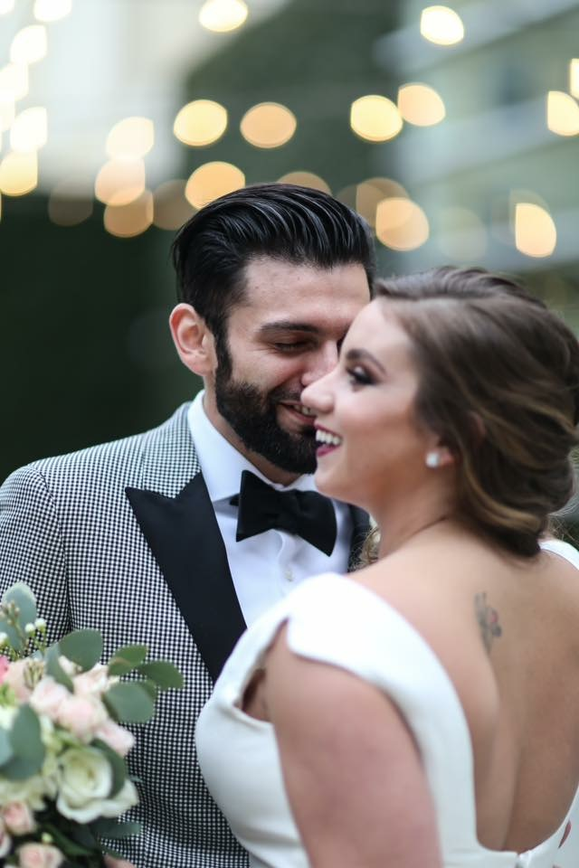 groom kissing bride's cheek and smiling kim baker beauty san jose california makeup artist palo alto