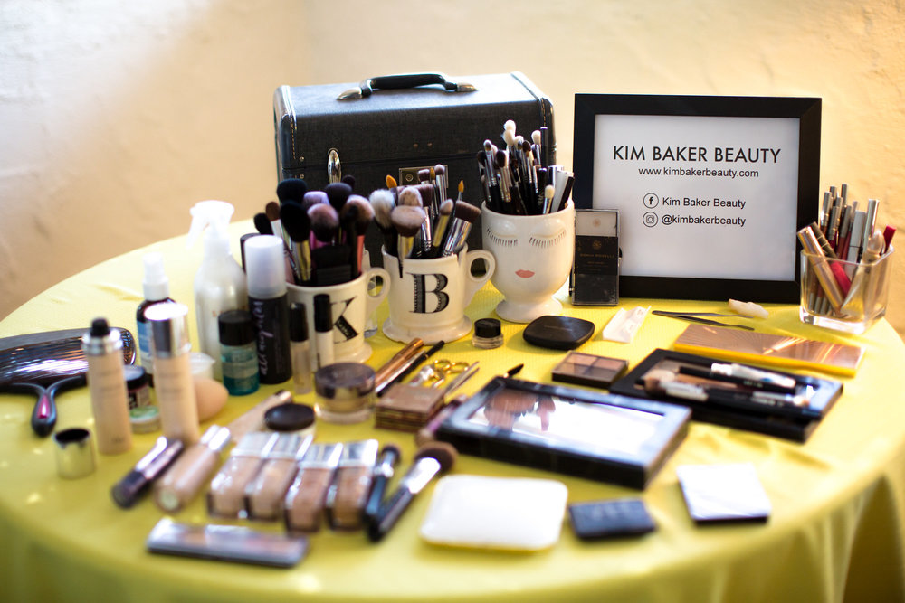 makeup products and tools set up for the bride with a classic train case and dior foundation kim baker beauty san jose makeup artist at the holly farm in carmel valley