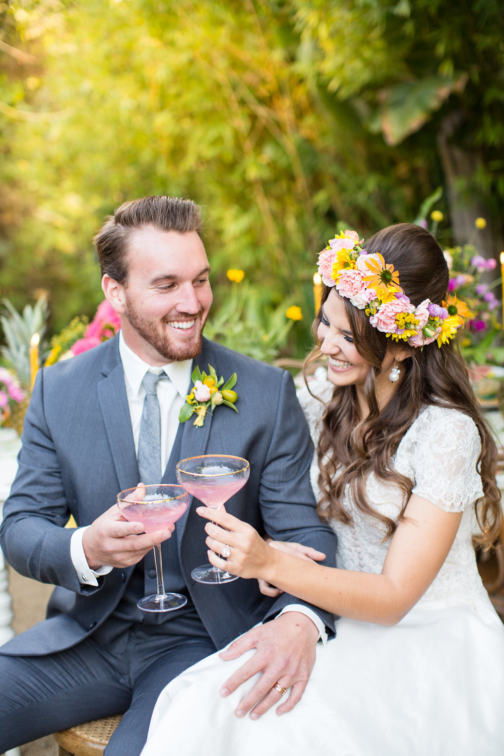 bride in flower crown and groom cheering with cocktails at wedding kim baker beauty san jose makeup artist at the holly farm in carmel valley
