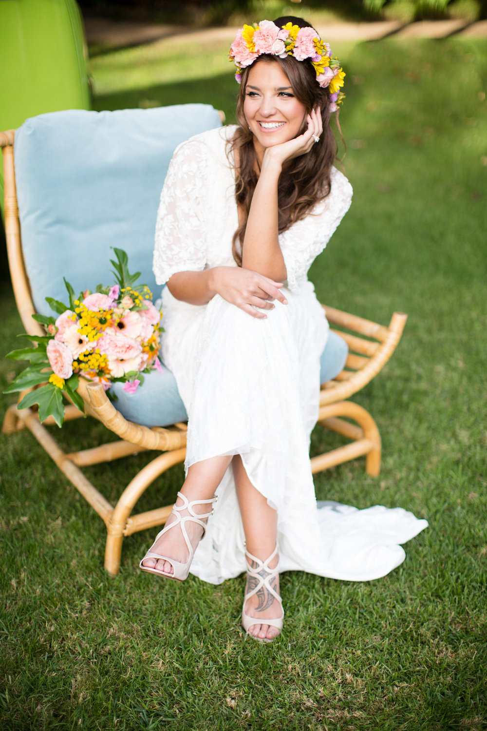 bride sitting on blue mid century modern tropical chair with flower crown and tropical bouquet kim baker beauty san jose california makeup artist wedding styled photoshoot at the holly farm in carmel