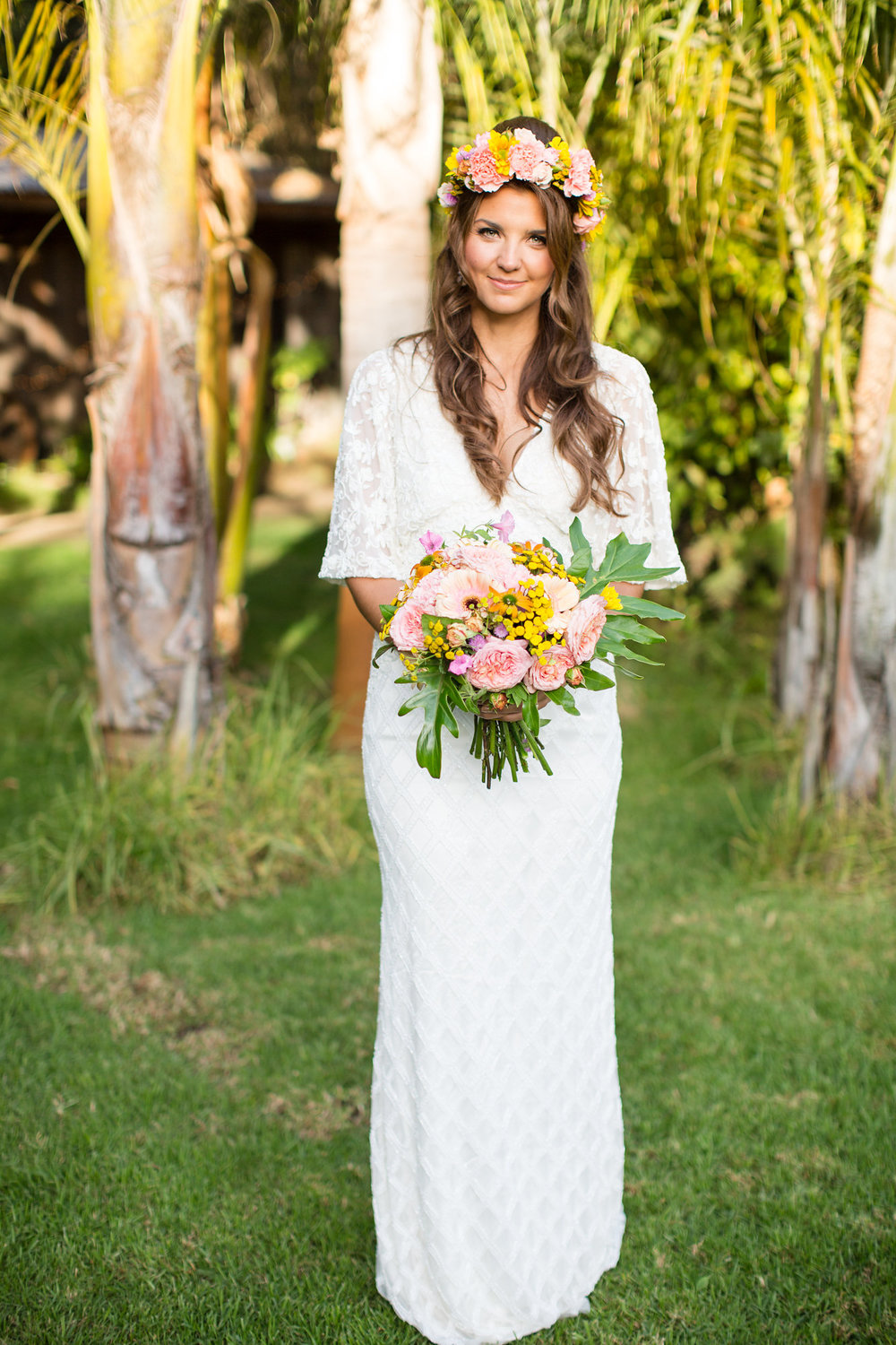 bride standing alone in beaded floor length gown holding large tropical bouquet kim baker beauty san jose california makeup artist wedding styled photoshoot at the holly farm in carmel