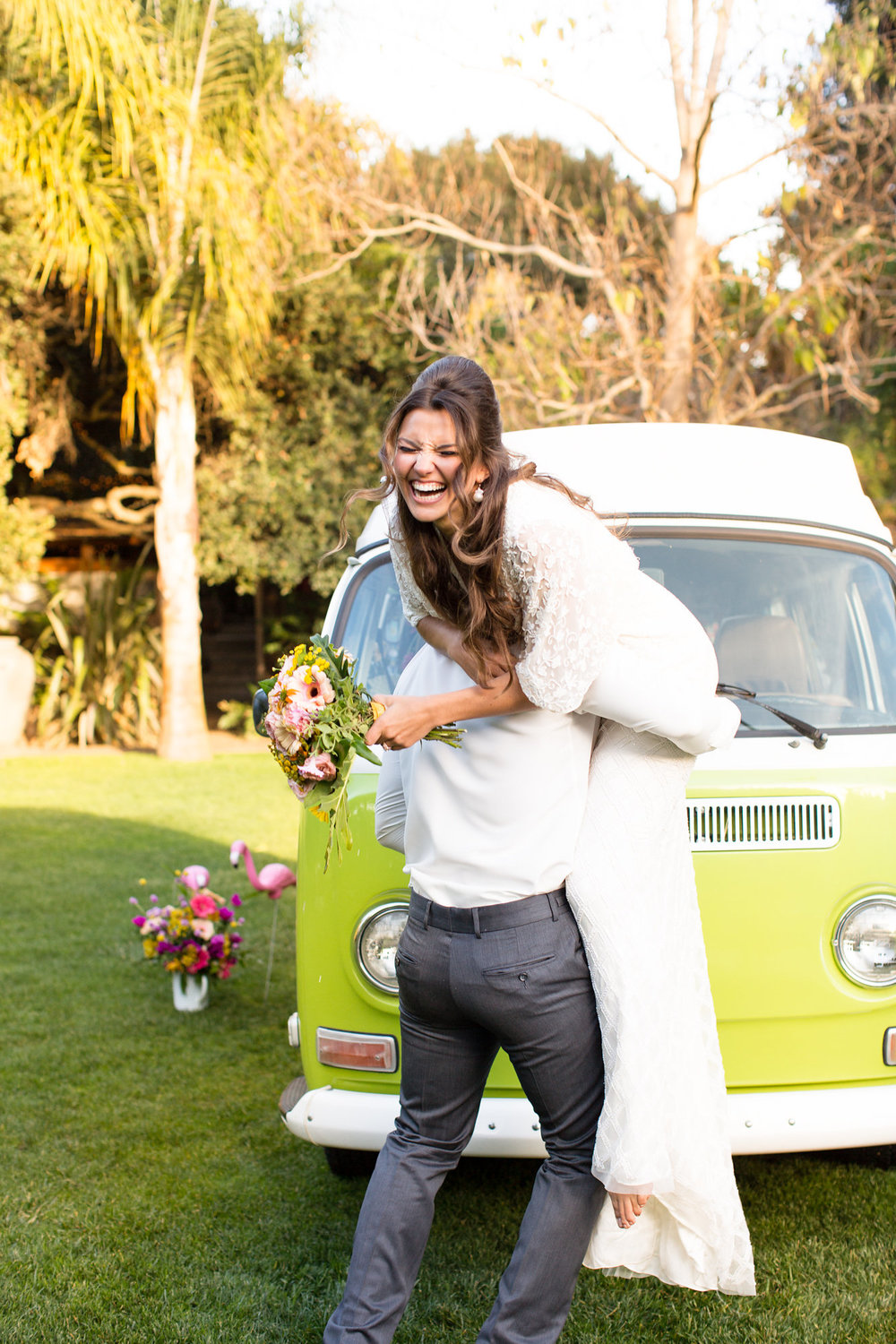 fun bride and groom playing together in front of green vw bus kim baker beauty san jose california makeup artist wedding styled photoshoot at the holly farm in carmel