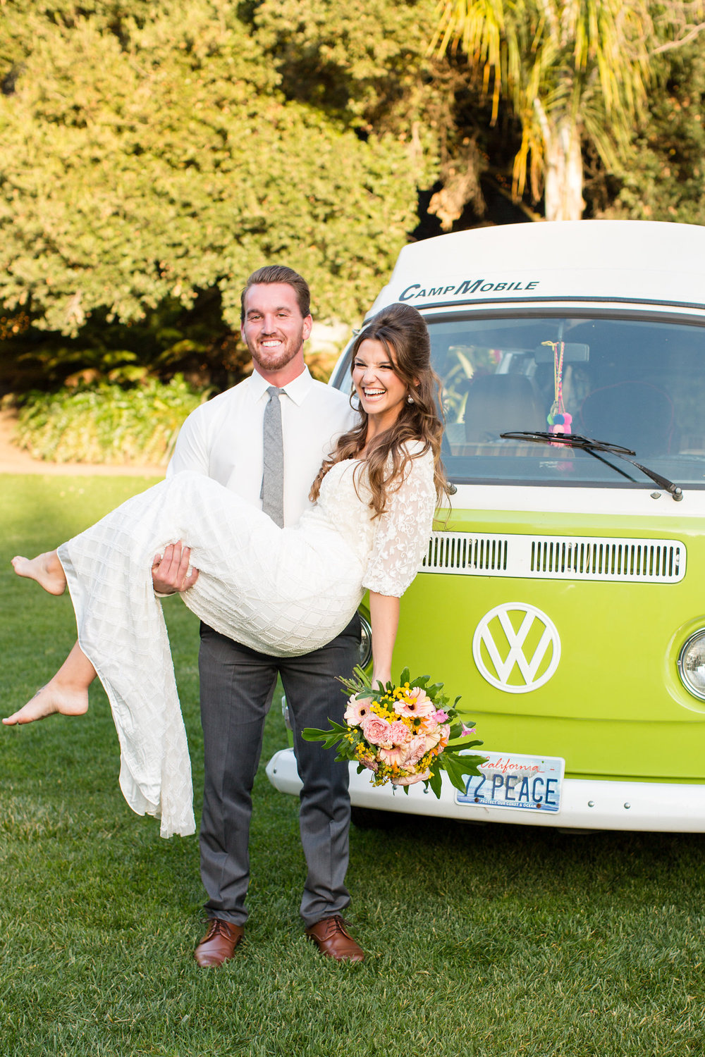 groom holding bride in front of green vw bus kim baker beauty san jose california makeup artist wedding styled photoshoot at the holly farm in carmel
