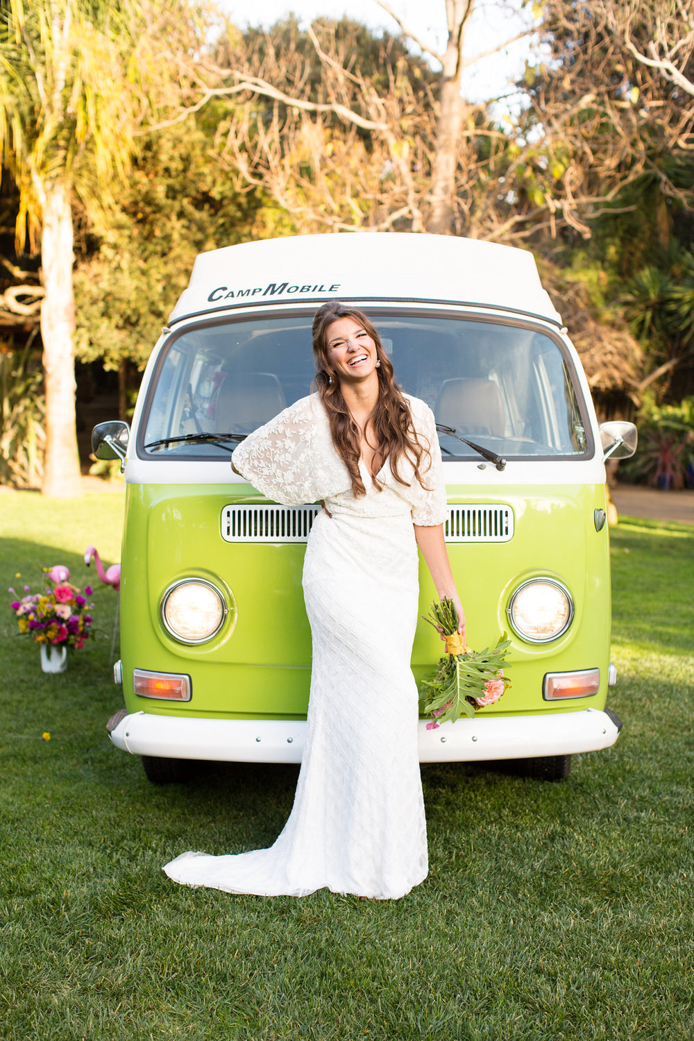 bride in beaded floor length gown with small train and dolman sleeves in front of green vw bus kim baker beauty san jose california makeup artist wedding styled photoshoot at the holly farm in carmel