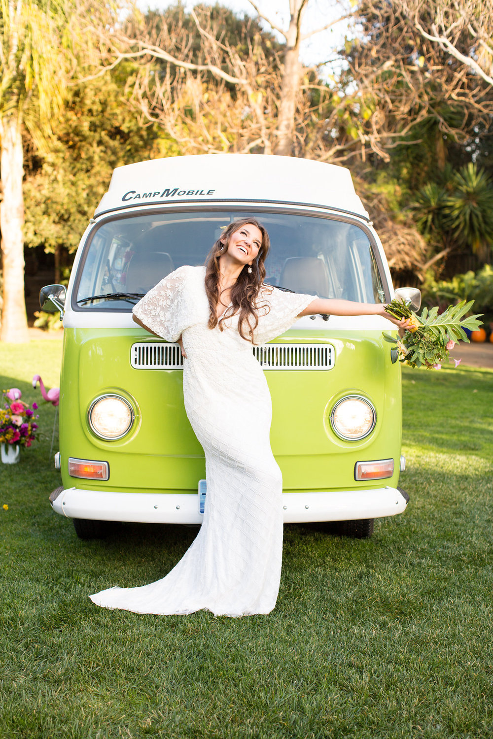 bride in front of green vw bus with tropical bouquet in a floor length beaded gown kim baker beauty san jose california makeup artist wedding styled photoshoot at the holly farm in carmel